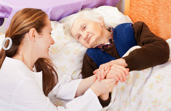 Female carer with elderly woman