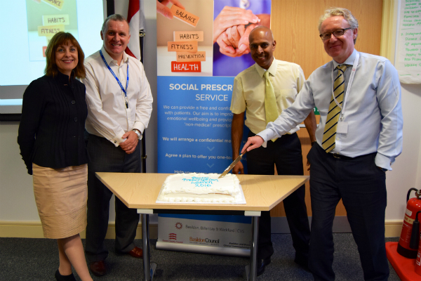 Unlocking Social Prescribing: cake cutting at launch event